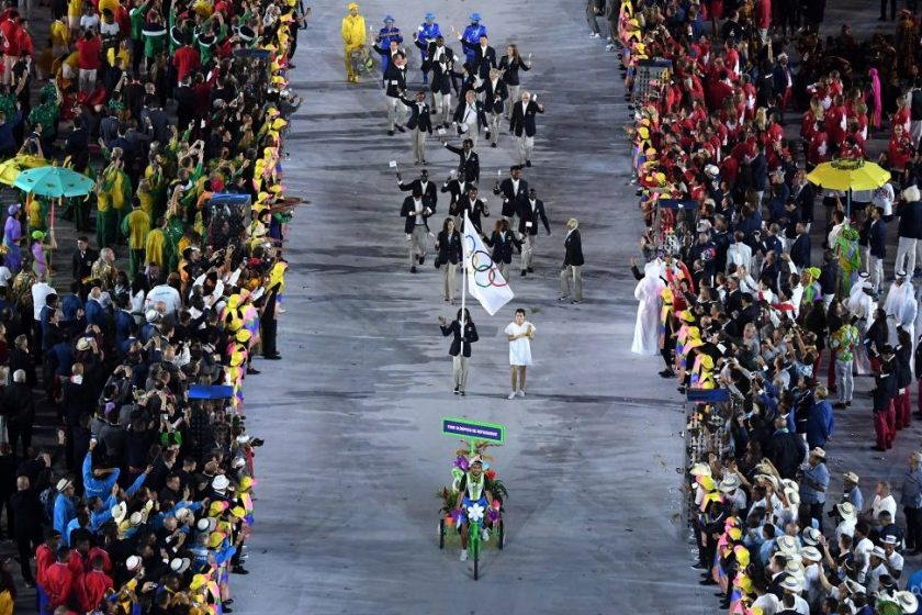 The Olympic Refugee team enter the athletes parade during the Opening Ceremony of the Rio 2016 Olympic Games at Maracana Stadium on August 5, 2016 in Rio de Janeiro, Brazil. (Richard Heathcote/Getty Images)