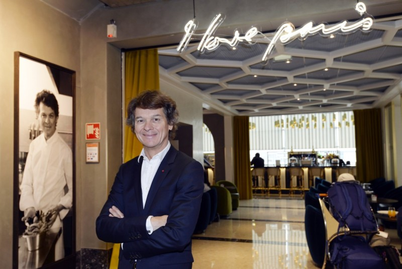 """French chef Guy Martin poses in his new restaurant """"I love Paris"""" at the International Airport Charles de Gaulle, northern Paris on July 17, 2015. AFP PHOTO / MIGUEL MEDINA (Photo credit should read MIGUEL MEDINA/AFP/Getty Images)"""