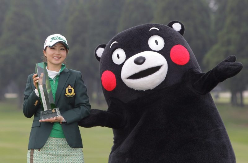 KIKUYO, JAPAN - APRIL 19: Erika Kikuchi of Japan lifts the trophy with Kumamoto prefecture's mascot Kumamon during a ceremony following the KKT Cup Vantelin Ladies Open at the Kumamoto Airport Country Club on April 19, 2015 in Kikuyo, Japan. (Photo by Chung Sung-Jun/Getty Images)