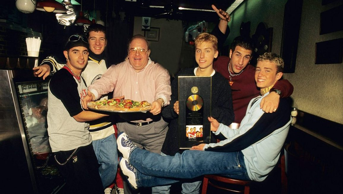 MIAMI - JUNE 06:    Lou Pearlman poses with N'Sync Chris Kirkpatrick,  JC Chasez,  Lance Bass,, Joey Fatone and Justin Timberlake seen at N.Y.P.D. pizza in Miami, circa 1996. (Photo by Mark Weiss/WireImage)