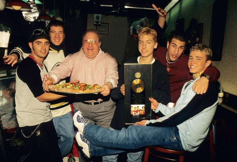 MIAMI - JUNE 06: Lou Pearlman pose with N'Sync Joey Fatone, Chris Kirkpatrick, JC Chasez, Lance Bass and Justin Timberlake seen at the N.Y.P.D. Pizza in Miami, circa 1996. (Photo by Mark Weiss/WireImage)