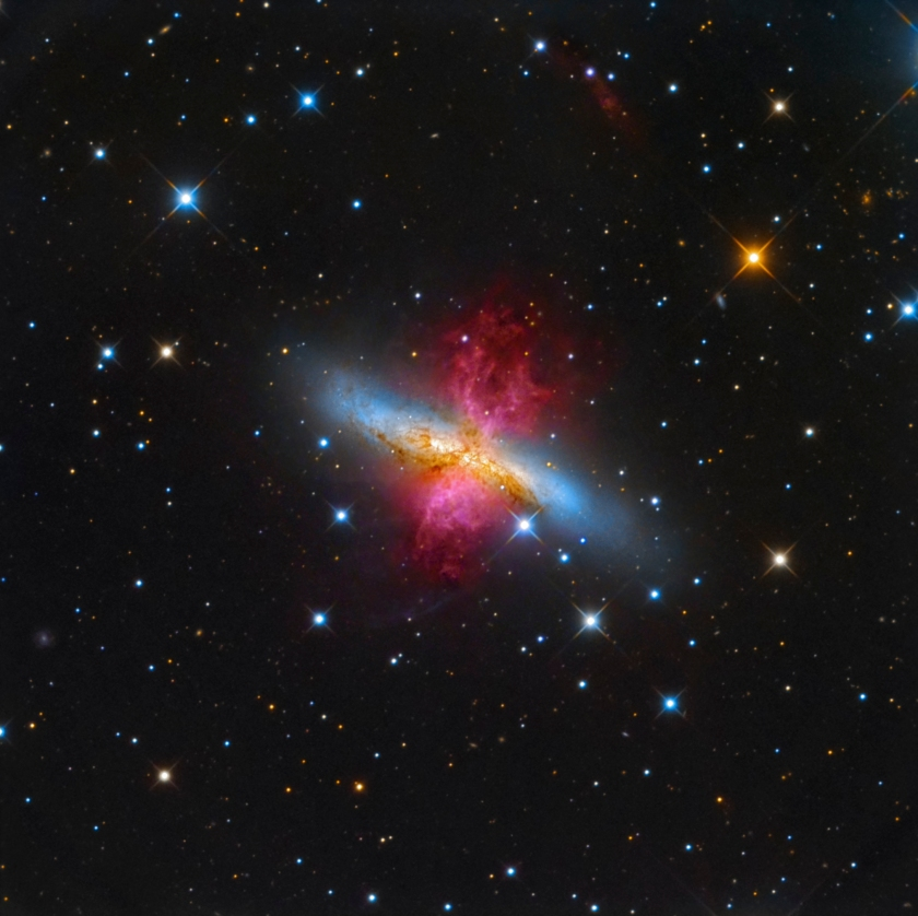 About 12 million light years away from our planet, lays the starburst galaxy M82, also known as the Cigar Galaxy. In a show of radiant red, the superwind bursts out from the galaxy, believed to be the closest place to our planet in which the conditions are similar to that of the early Universe, where a plethora of stars are forming. (Leonardo Orazi)