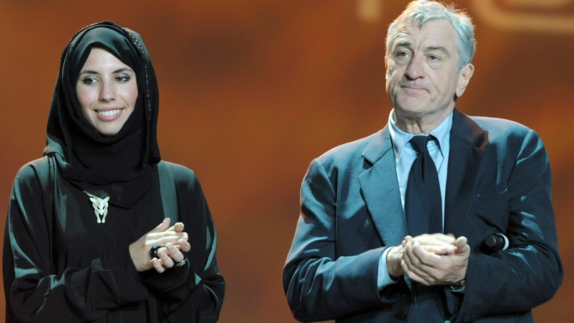 DOHA, QATAR - NOVEMBER 01:  Sophia Al-Maria and Tribeca Film Festival Co-founder Robert De Niro speak onstage at the DTFF Closing Night Ceremony at the Museum of Islamic Art during the 2009 Doha Tribeca Film Festival on November 1, 2009 in Doha, Qatar.  (Photo by Michael Buckner/Getty Images for Doha Tribeca Film Festival)