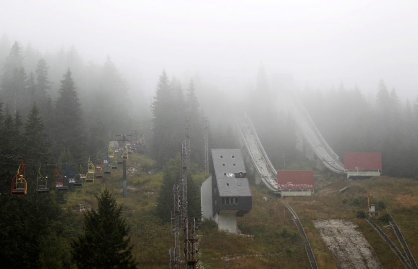 A general view of the disused ski jump from the Sarajevo 1984 Winter Olympics shrouded in mist on Mount Igman, near Sarajevo September 19, 2013. Abandoned and left to crumble into oblivion, most of the 1984 Winter Olympic venues in Bosnia's capital Sarajevo have been reduced to rubble by neglect as much as the 1990s conflict that tore apart the former Yugoslavia. (Reuters/Dado Ruvic)