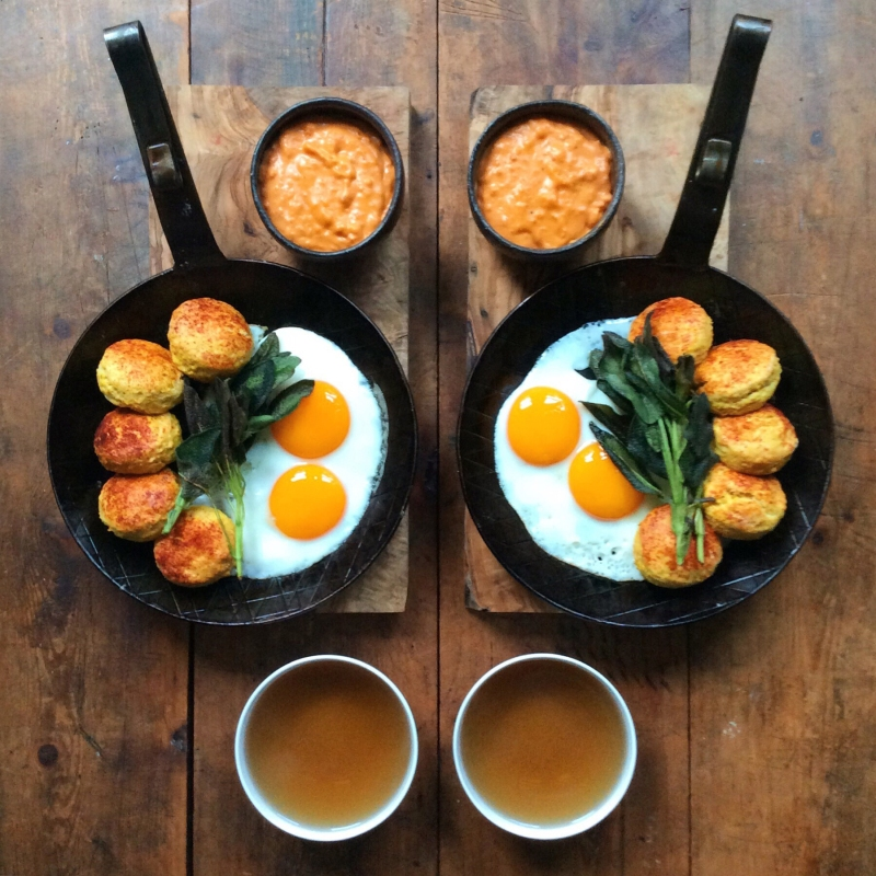 Paprika biscuits with eggs and a sobrassada gravy (From SymmetryBreakfast by Michael Zee, published by powerHouse Books)