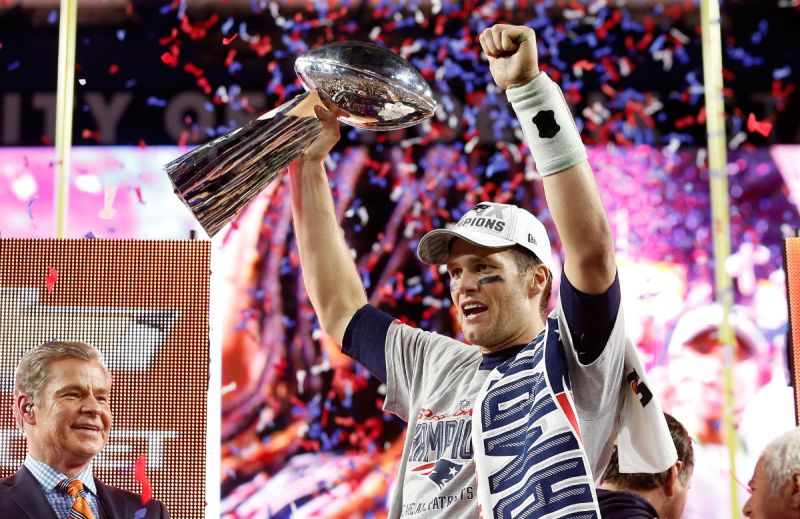 Tom Brady #12 of the New England Patriots celebrates with the Vince Lombardi Trophy after defeating the Seattle Seahawks 28-24 to win Super Bowl XLIX at University of Phoenix Stadium on February 1, 2015 in Glendale, Arizona. (Photo by Christian Petersen/Getty Images)
