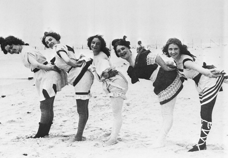 (Original Caption) Bathing beauties in coy pose, at Coney Island, 1897. Stereoscopic view by Stroyhmeyer and Wynn.