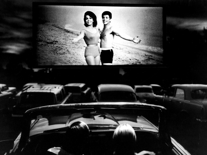 (L-R) Actors Annette Funicello and Frankie Avalon in scene fr. film Beach Blanket Bingo, shown at drive-in movie theater. (Photo by Henry Groskinsky/The LIFE Picture Collection/Getty Images)