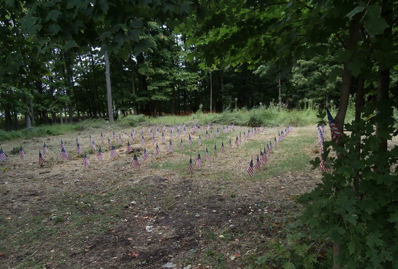 Photo of the burial ground taken after the conclusion of the 4th annual Revolutionary War Weekend. 60 flags were placed to represent the 60 soldiers identified by our research team up to that point. Our count now stands at 86. (Friends of the Fishkill Supply Depot)