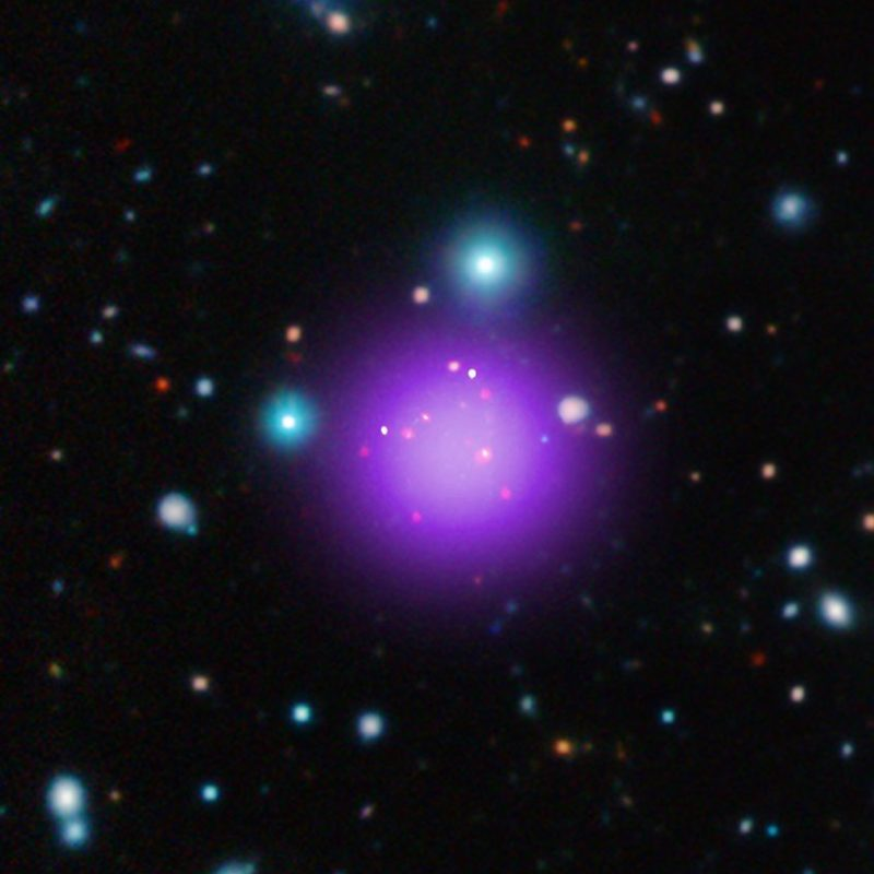 This image contains the most distant galaxy cluster, a discovery made using data from NASA's Chandra X-ray Observatory and several other telescopes. The galaxy cluster, known as CL J1001+0220, is located about 11.1 billion light years from Earth and may have been caught right after birth, a brief, but important stage of cluster evolution never seen before. (NASA)