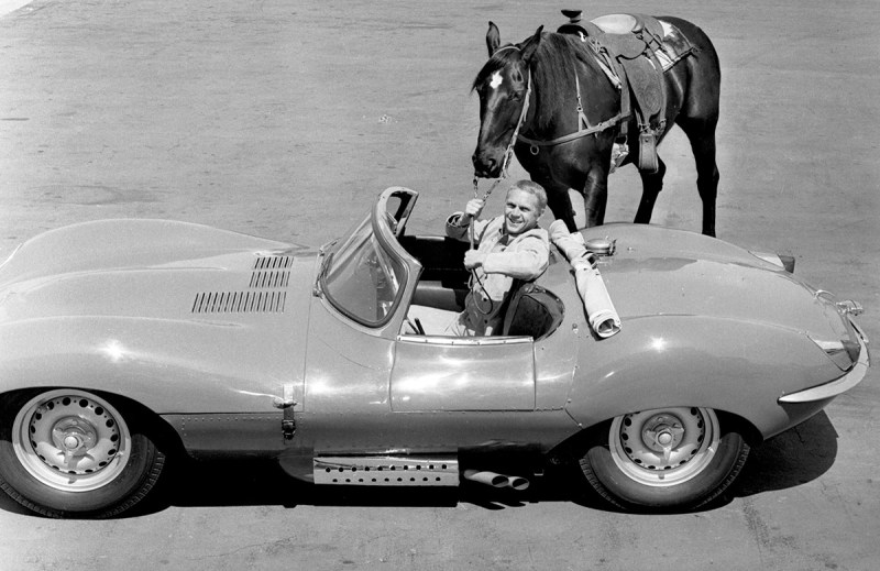 Steve McQueen with his horse and his Jaguar XK-SS, special racing model. (CBS via Getty Images)