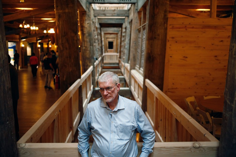 """Kenneth """"Ken"""" Ham, president of Answers in Genesis of Kentucky Inc., stands for a photograph inside the Noah's Ark replica at the Ark Encounter theme park in Williamstown, Kentucky, U.S., on Tuesday, July 5, 2016. Ham and his group created a full-scale replica of Noah's Ark to match its description in the bible. The massive 510-foot wooden ship has cost an estimate of over $100 million to produce. Photographer: Luke Sharrett/Bloomberg via Getty Images"""