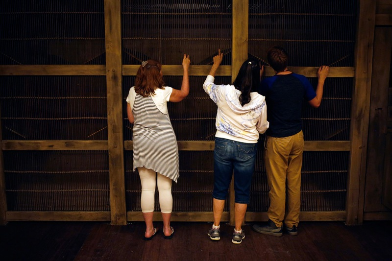 Attendees view inside a cage containing model animals in the Noah's Ark replica at the Ark Encounter theme park in Williamstown, Kentucky, U.S., on Tuesday, July 5, 2016. Ken Ham, president of Answers in Genesis of Kentucky Inc., and his group created a full-scale replica of Noah's Ark to match its description in the bible. The massive 510-foot wooden ship has cost an estimate of over $100 million to produce. Photographer: Luke Sharrett/Bloomberg via Getty Images
