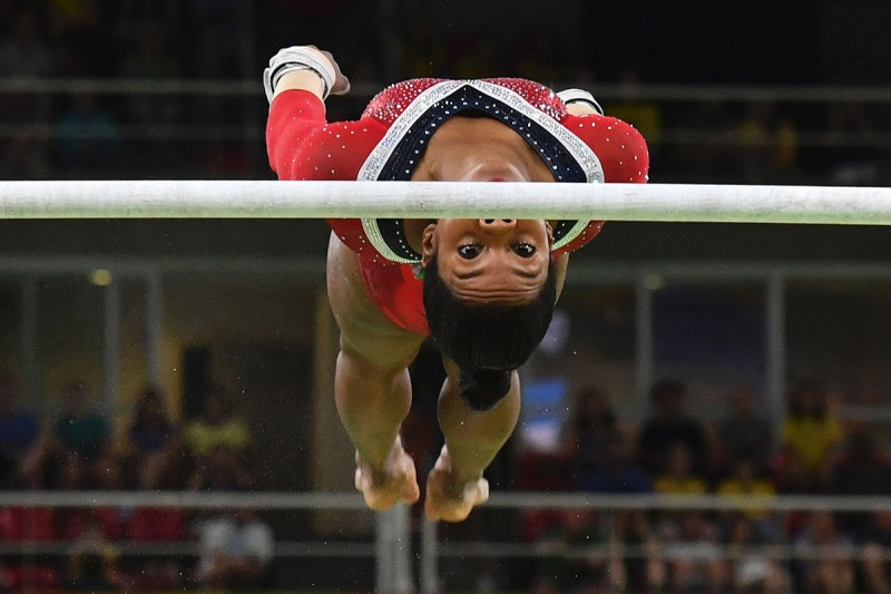 TOPSHOT - US gymnast Gabrielle Douglas competes in the women's uneven bars event final of the Artistic Gymnastics at the Olympic Arena during the Rio 2016 Olympic Games in Rio de Janeiro on August 14, 2016. / AFP / Ben STANSALL (Photo credit should read BEN STANSALL/AFP/Getty Images)