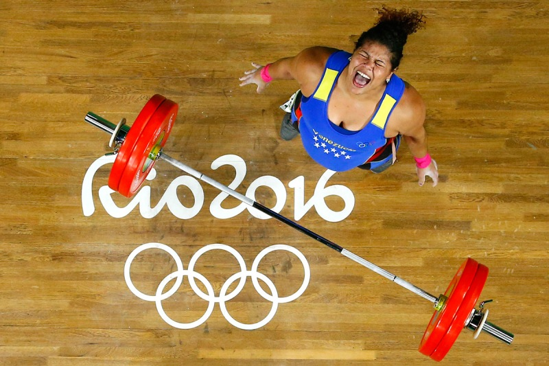 TOPSHOT - Venezuela's Yaniuska Isabel Espinosa reacts while competing during the Women's weightlifting +75kg event at the Rio 2016 Olympic Games in Rio de Janeiro on August 14, 2016 / AFP / POOL / STR (Photo credit should read STR/AFP/Getty Images)