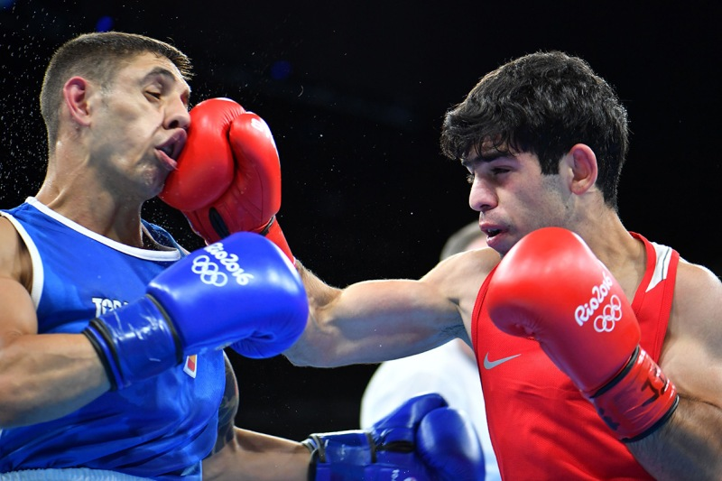 TOPSHOT - Armenia's Artur Hovhannisyan (R) lands a punch on Spain's Samuel Carmona Heredia during the Men's Light Fly (46-49kg) match at the Rio 2016 Olympic Games at the Riocentro - Pavilion 6 in Rio de Janeiro on August 6, 2016. / AFP / Yuri CORTEZ (Photo credit should read YURI CORTEZ/AFP/Getty Images)