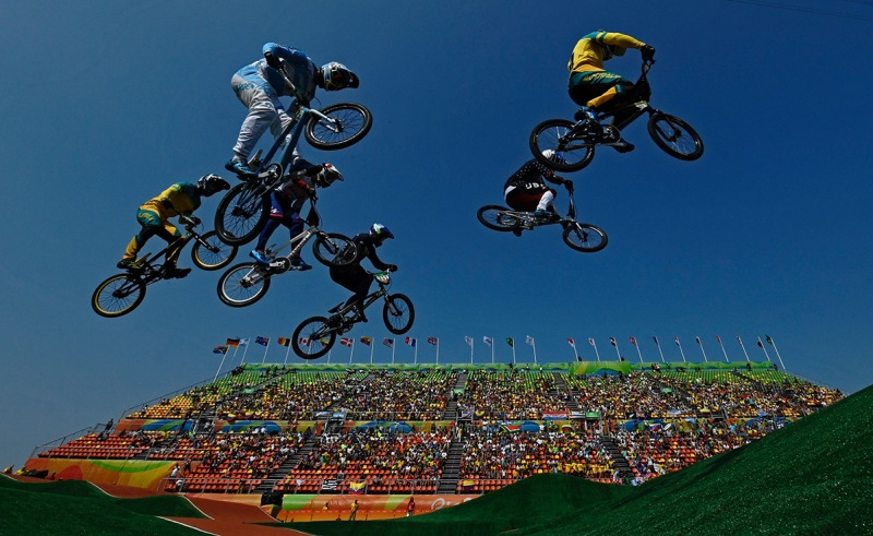 TOPSHOT - Riders compete in the BMX cycling men's quarterfinals event at the X-Park BMX venue in Deodoro during the Rio 2016 Olympic Games in Rio de Janeiro on August 18, 2016. / AFP / CARL DE SOUZA (Photo credit should read CARL DE SOUZA/AFP/Getty Images)