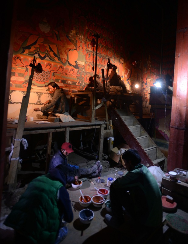 In this photograph taken on June 15, 2016, Nepalese artists restore sacred murals in a monastry in Lo Manthang in Upper Mustang. Deep in the heart of a medieval monastery in Nepal's remote Upper Mustang region, the battle to restore sacred murals and preserve traditional Tibetan Buddhist culture is in full swing. / AFP / PRAKASH MATHEMA / To go with 'Nepal-Tibet-Buddhism-Architecture-Painting' FEATURE by Ammu Kannampilly (Photo credit should read PRAKASH MATHEMA/AFP/Getty Images)