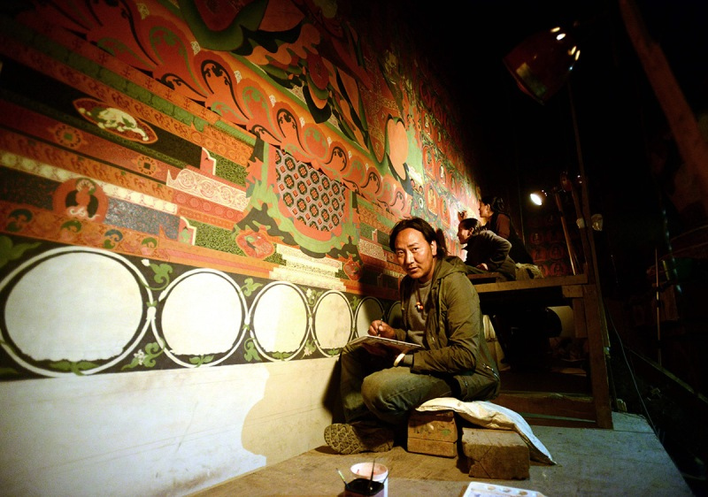 In this photograph taken on June 15, 2016, Nepalese artist Tsewang Jigme looks up during an interview with AFP in Lo Manthang in Upper Mustang. Deep in the heart of a medieval monastery in Nepal's remote Upper Mustang region, the battle to restore sacred murals and preserve traditional Tibetan Buddhist culture is in full swing. / AFP / PRAKASH MATHEMA / To go with 'Nepal-Tibet-Buddhism-Architecture-Painting' FEATURE by Ammu Kannampilly (Photo credit should read PRAKASH MATHEMA/AFP/Getty Images)