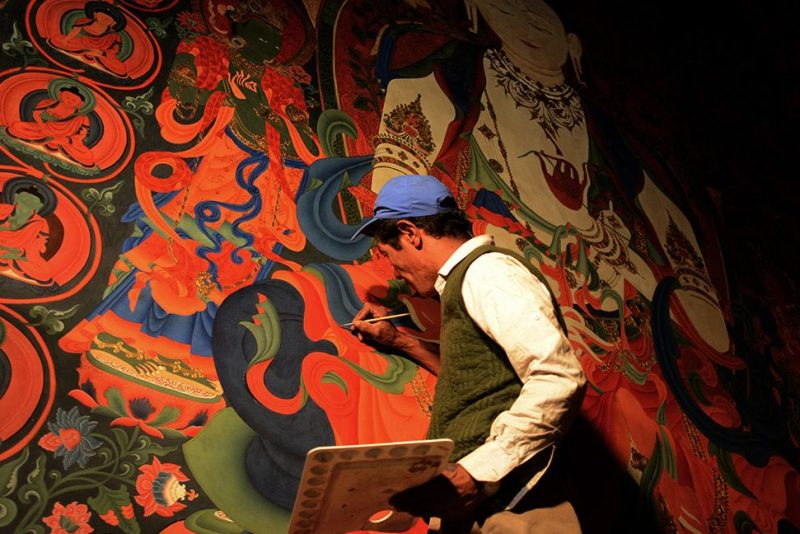In this photograph taken on June 15, 2016, a Nepalese artist restores sacred murals in a monastry in Lo Manthang in Upper Mustang. Deep in the heart of a medieval monastery in Nepal's remote Upper Mustang region, the battle to restore sacred murals and preserve traditional Tibetan Buddhist culture is in full swing. / AFP / PRAKASH MATHEMA / To go with 'Nepal-Tibet-Buddhism-Architecture-Painting' FEATURE by Ammu Kannampilly (Photo credit should read PRAKASH MATHEMA/AFP/Getty Images)