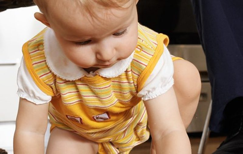 Child eating off floor. (Getty Images)