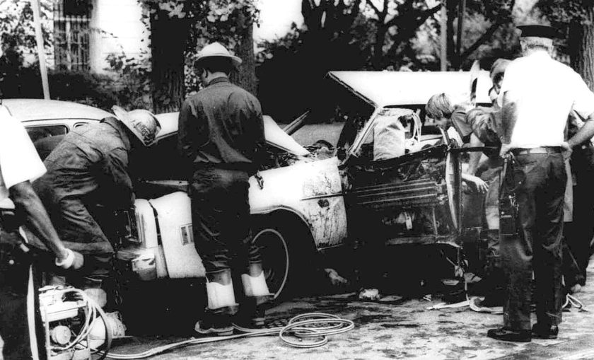 Firemen remove victims from a car shattered by a bomb blast on Embassy Row in Washington, D.C. Sept. 21, 1976. Orlando Letelier, former Chilean ambassador to the U.S., and Ronne Karpen Moffitt, his aide, were both killed in the blast. (AP Photo)