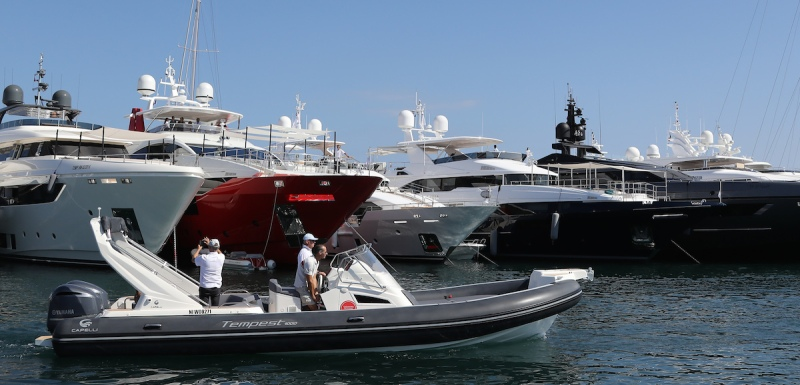 """People visit the """"Yachting Festival"""", a yearly yachting event which gathers 500 exhibitors on September 6, 2016 in Cannes, southeastern France. / AFP / VALERY HACHE (Photo credit should read VALERY HACHE/AFP/Getty Images)"""