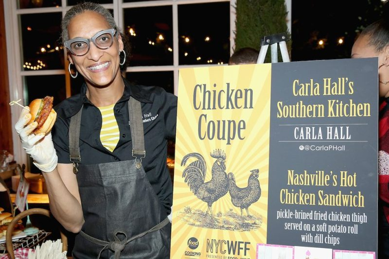 NEW YORK, NY - OCTOBER 15: Carla Hall, Co-host of The Chew, and owner of Carla Halls Southern Kitchen poses with her dish; Nashville's Hot Chicken Sandwich at Chicken Coupe hosted by Whoopi Goldberg during Food Network & Cooking Channel New York City Wine & Food Festival presented by FOOD & WINE at The Loeb Boathouse on October 15, 2015 in New York City. (Photo by Monica Schipper/Getty Images for NYCWFF)