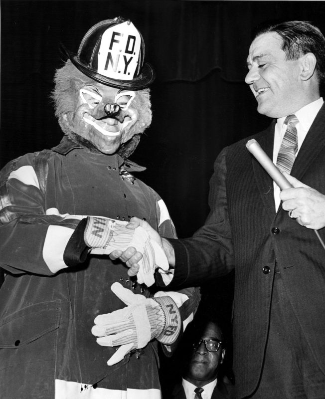 Foxy the firefighter appeared today for the inauguration of a Crusade to save lives and is introduced by the fire Commish. Edward Thompson, during ceremonies at the high school of fashion industries. March 13, 1964. (Photo by Louis Liotta / (c) NYP Holdings, Inc. via Getty Images)