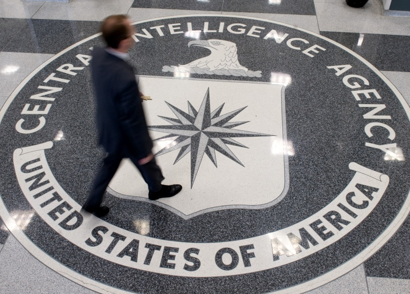 A man crosses the Central Intelligence Agency (CIA) logo in the lobby of CIA Headquarters in Langley, Virginia, on August 14, 2008. (Saul Loeb/AFP/Getty Images)