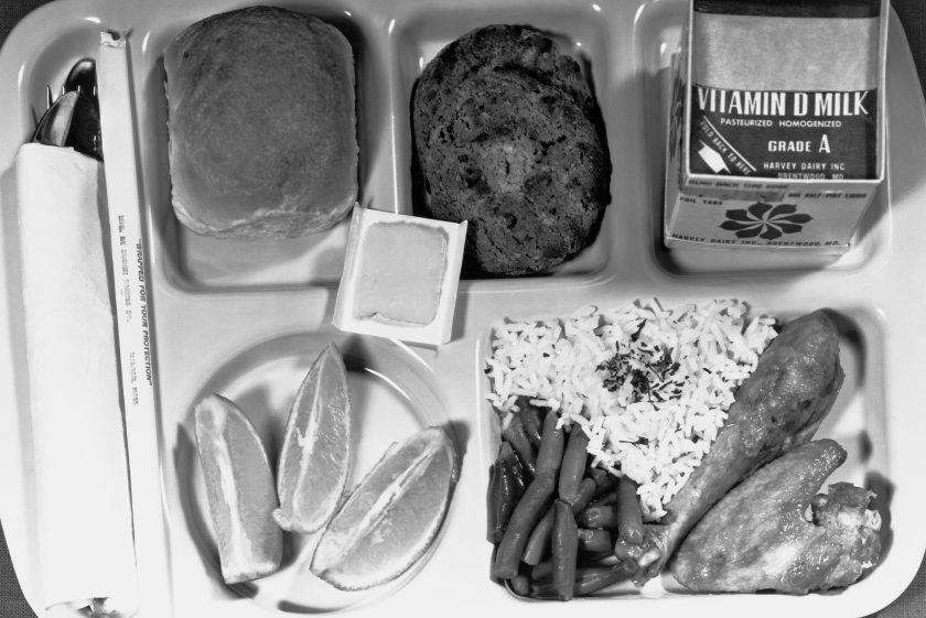 A Type A school lunch as specified by the Department of Agriculture, with a protein food, fruits, vegetables, bread and butter, and milk, Washington DC, June 1, 1966. ( Underwood Archives/Getty Images)