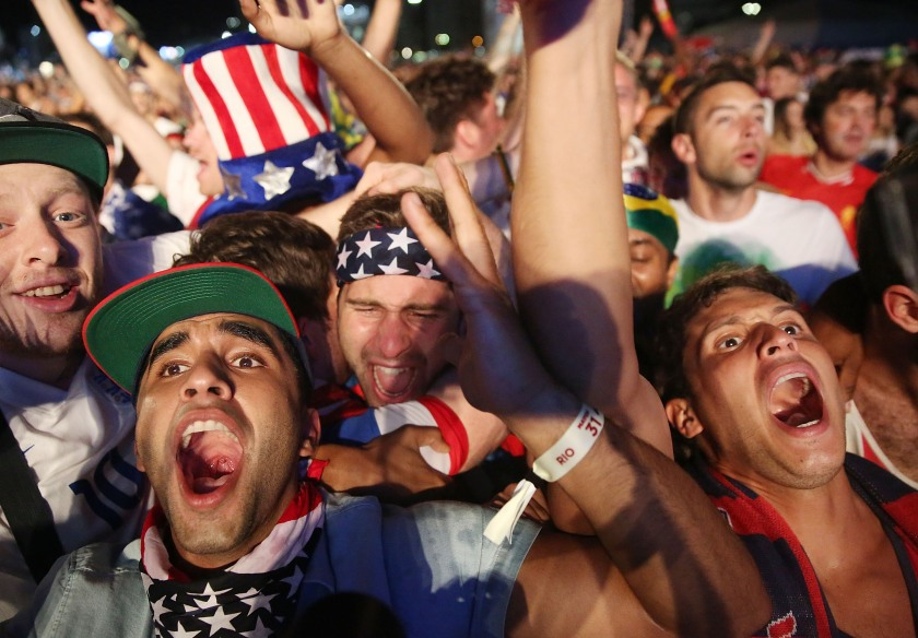 American fans celebrate after the U.S. scored to take a 2-1 lead over Portugal while watching a video broadcast at the FIFA Fan Fest on Copacabana Beach during the 2014 FIFA World Cup Brazil on June 22, 2014 in Rio de Janeiro, Brazil. The game ended in a 2-2 tie. (Photo by Mario Tama/Getty Images)