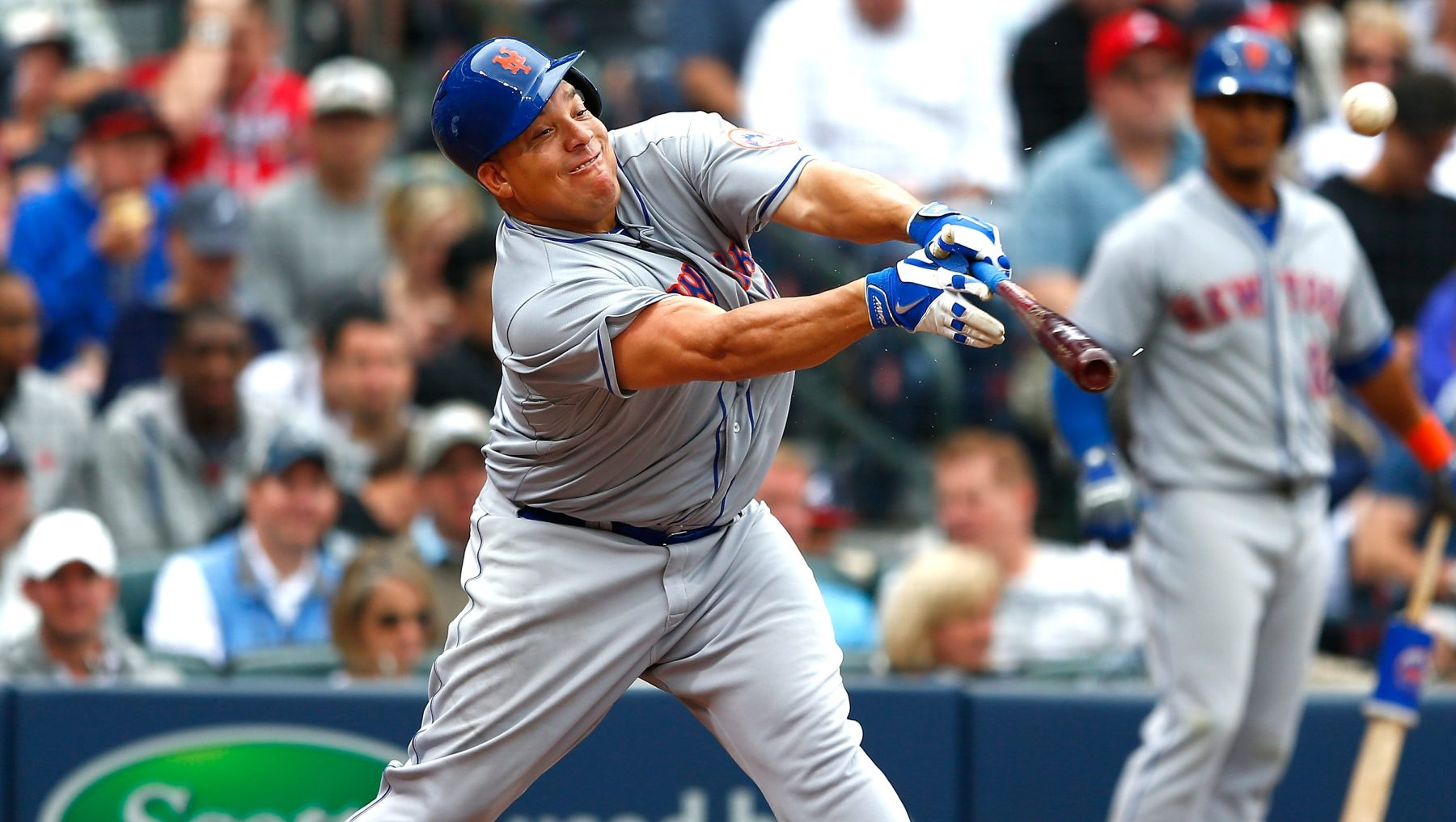 Bartolo Colon #40 of the New York Mets hits a RBI single into right field against the Atlanta Braves during the Braves opening series at Turner Field on April 12, 2015 in Atlanta, Georgia.  Wilmer Flores #4 scored on the single.  (Kevin C. Cox/Getty Images)