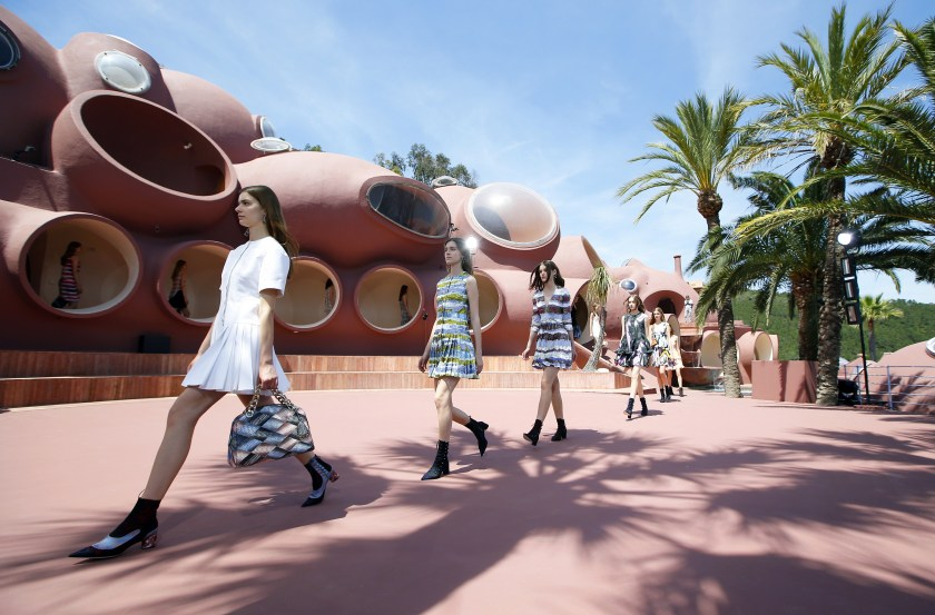 Models present creations by Belgian fashion designer Raf Simons during the Dior 2016 cruise collection show, on May 11, 2015 at the Palais Bulle in Theoule-sur-Mer, southeastern France. (Valery Hache/AFP/Getty Images)
