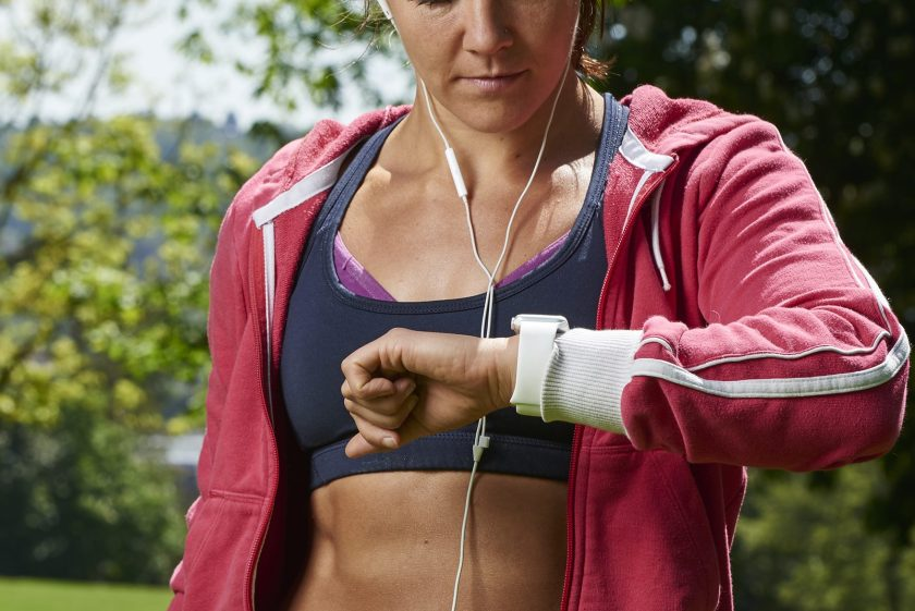 Portrait of a woman in sportswear checking an Apple Watch Sport, taken on May 21, 2015. (Photo by Joseph Branston/Future Publishing via Getty Images)