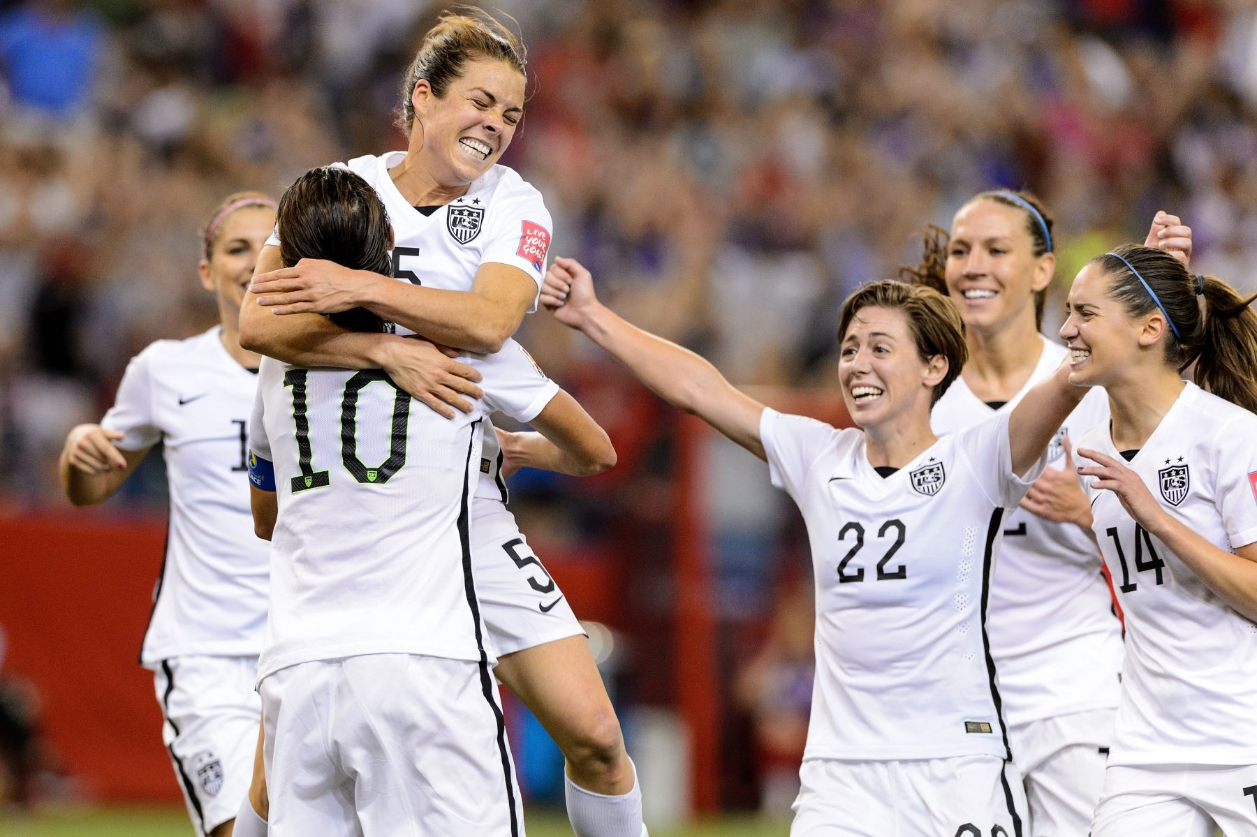Kelley O'Hara #5 of the United States celebrates with teammates after scoring a goal in the second half against Germany in the FIFA Women's World Cup 2015 Semi-Final Match at Olympic Stadium on June 30, 2015 in Montreal, Canada.  (Photo by Minas Panagiotakis/Getty Images)