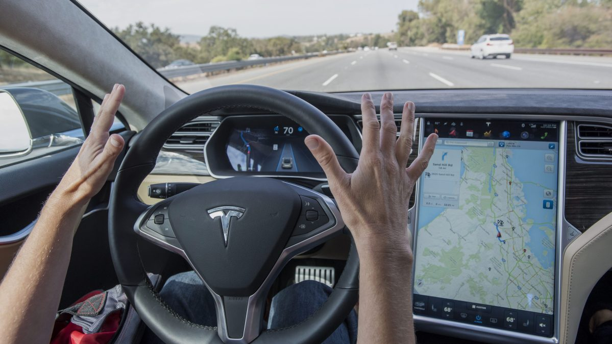 A member of the media test drives a Tesla Motors Inc. Model S car equipped with Autopilot in Palo Alto, California, U.S., on Wednesday, Oct. 14, 2015. (David Paul Morris/Bloomberg via Getty Images)
