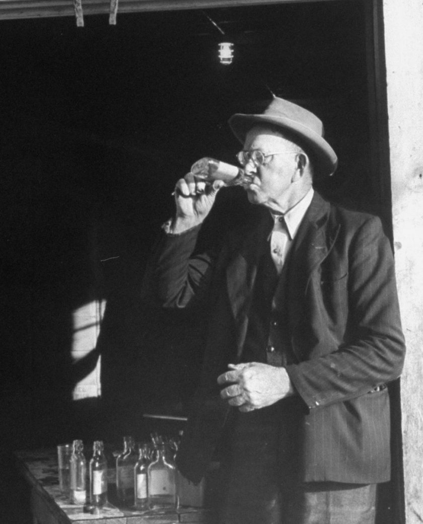 Tasters testing whiskey at the Jack Daniels distillery. (Photo by Ed Clark/The LIFE Picture Collection/Getty Images)
