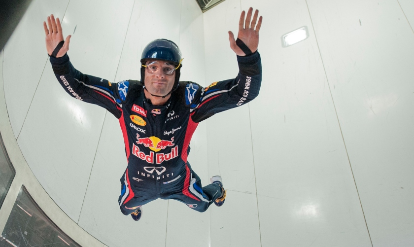 Red Bull Racing driver Mark Webber of Australia practices indoor skydiving in a vertical wind tunnel. (Victor Fraile/Corbis via Getty Images)