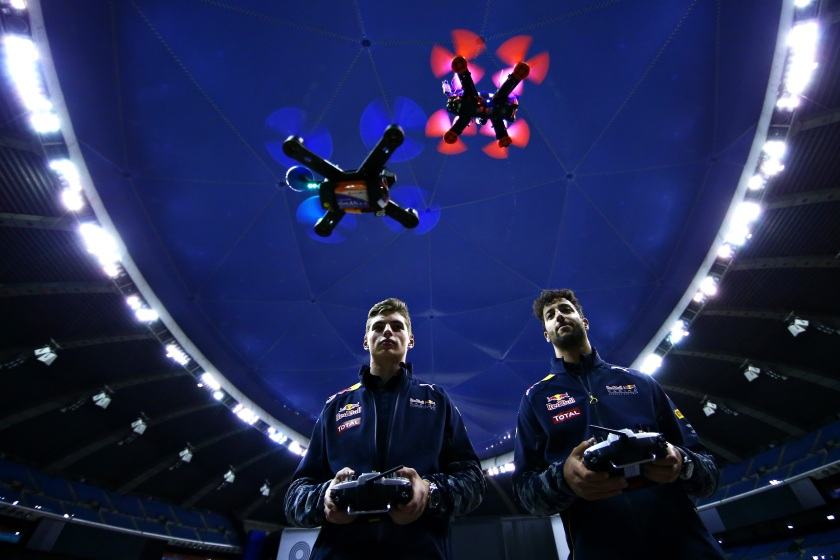 Daniel Ricciardo of Australia and Red Bull Racing and Max Verstappen of Netherlands and Red Bull Racing race drones on June 8, 2016 in Montreal, Canada. (Dan Istitene/Getty Images)