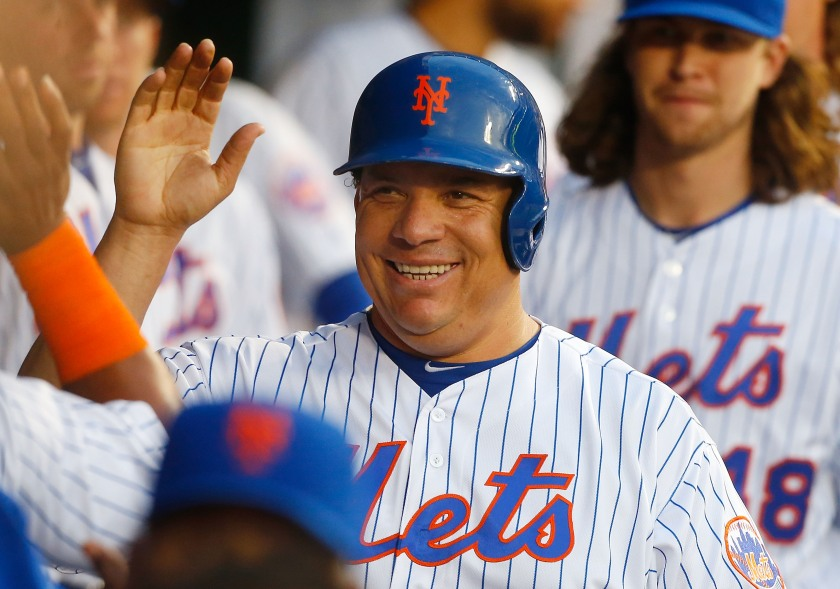 Bartolo Colon #40 of the New York Mets celebrates in the dugout after scoring a third-inning run against the Pittsburgh Pirates at Citi Field on June 16, 2016 in the Flushing neighborhood of the Queens borough of New York City. (Jim McIsaac/Getty Images)