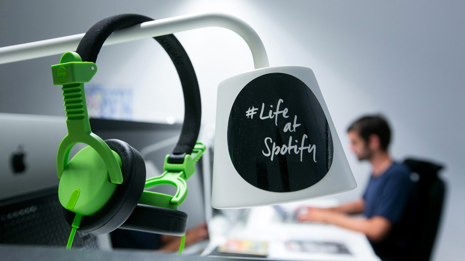 A pair of audio headphones hang from a lamp shade inside the offices music streaming company Spotify Ltd. (Krisztian Bocsi/Bloomberg via Getty Images)