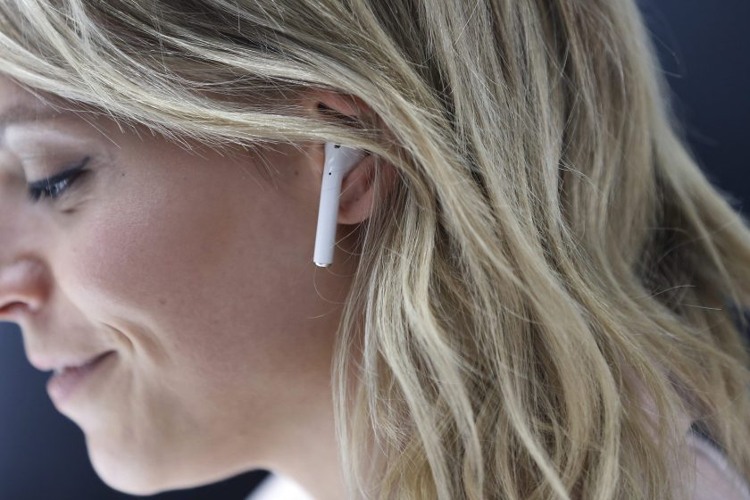 An attendee wears an Apple AirPods during a launch event on September 7, 2016 in San Francisco, California. Apple Inc. unveiled the latest iterations of its smart phone, the iPhone 7 and 7 Plus, the Apple Watch Series 2, as well as AirPods, the tech giant's first wireless headphones. (Stephen Lam/Getty Images)