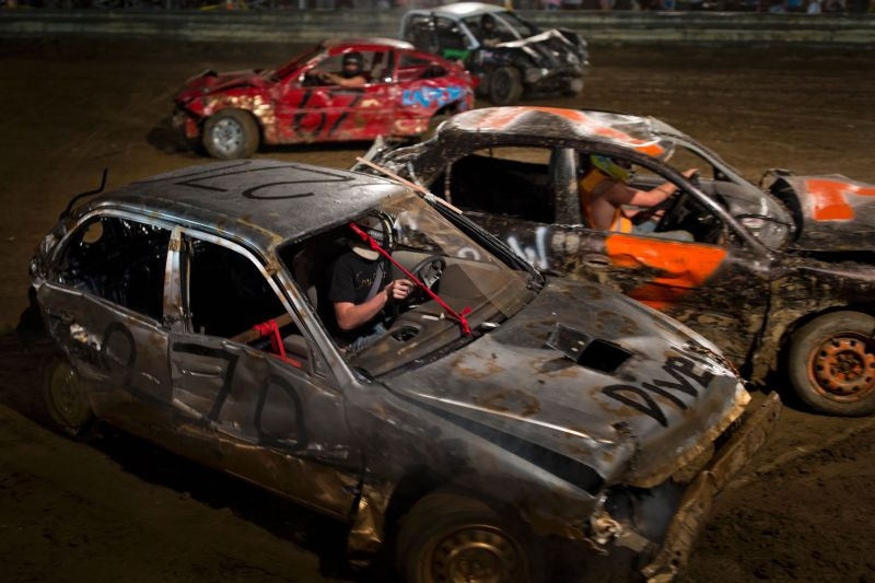 Drivers compete in the annual demolition derby at the Cambria County Fair on September 8, 2016, in Ebensburg, Pennsylvania. In the tiny Pennsylvania town of Ebensburg, deep in the heart of America's Rust Belt, 80 cars signed up for the demolition derby at the Cambria County Fair. By the end, there were only two winners -- and 80 wrecks. / AFP / DOMINICK REUTER (Photo credit should read DOMINICK REUTER/AFP/Getty Images)