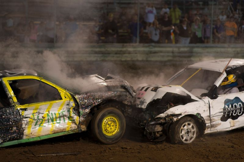 The two final drivers go head to head for the championship in the six-cylinder category in the annual demolition derby at the Cambria County Fair on September 8, 2016, in Ebensburg, Pennsylvania. In the tiny Pennsylvania town of Ebensburg, deep in the heart of America's Rust Belt, 80 cars signed up for the demolition derby at the Cambria County Fair. By the end, there were only two winners -- and 80 wrecks. / AFP / DOMINICK REUTER (Photo credit should read DOMINICK REUTER/AFP/Getty Images)