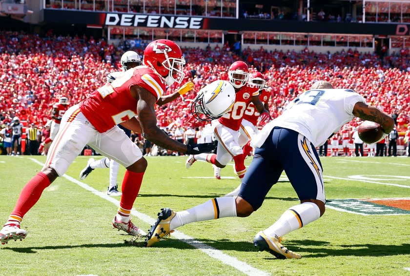 KANSAS CITY, MO - SEPTEMBER 11: Defensive back Marcus Peters #22 of the Kansas City Chiefs rips the helmet off of wide receiver Keenan Allen #13 of the San Diego Chargers during the game at Arrowhead Stadium on September 11, 2016 in Kansas City, Missouri. (Photo by Jamie Squire/Getty Images)