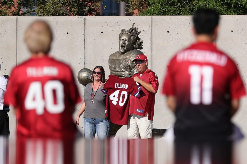Fans pose in front of the Pat Tillman statue before the NFL game between the Arizona Cardinals and New England Patriots at the University of Phoenix Stadium on September 11, 2016 in Glendale, Arizona. (Christian Petersen/Getty Images)