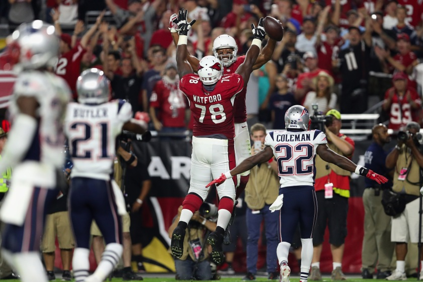 GLENDALE, AZ - SEPTEMBER 11: Wide receiver Larry Fitzgerald #11 of the Arizona Cardinals celebrates his 100th career touchdown with offensive tackle Earl Watford #78 during the fourth quarter of the NFL game against the New England Patriots at the University of Phoenix Stadium on September 11, 2016 in Glendale, Arizona. (Photo by Christian Petersen/Getty Images)