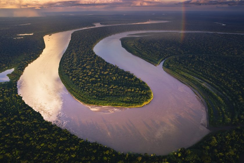 Aerial view of Madre de Dios River winding through Amazonian rain forest. (Theo Allofs/ Corbis Documentary)