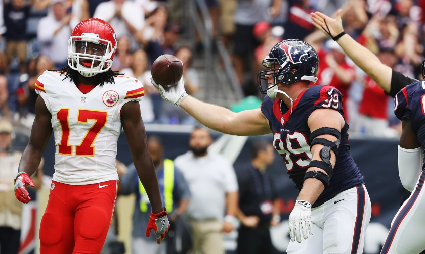 J.J. Watt #99 of the Houston Texans celebrates a fumble recovery as Chris Conley #17 of the Kansas City Chiefs looks on in the first quarter of their game at NRG Stadium on September 18, 2016 in Houston, Texas. (Scott Halleran/Getty Images)